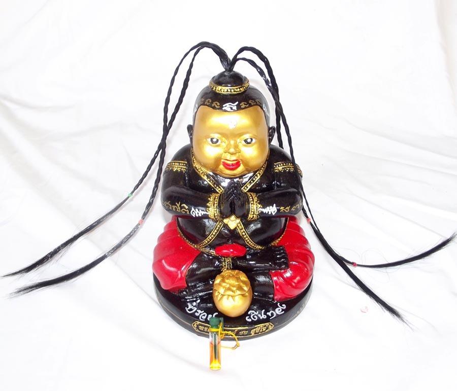 Kumarn Tong Raay Montr Jao Sap (Sorceror Kumarn Casting Spells of Riches) Bucha Statue