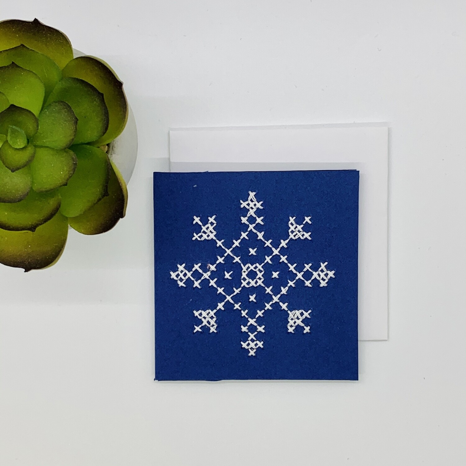 Small Card, White Snowflake Cross-stitch on Dark Blue