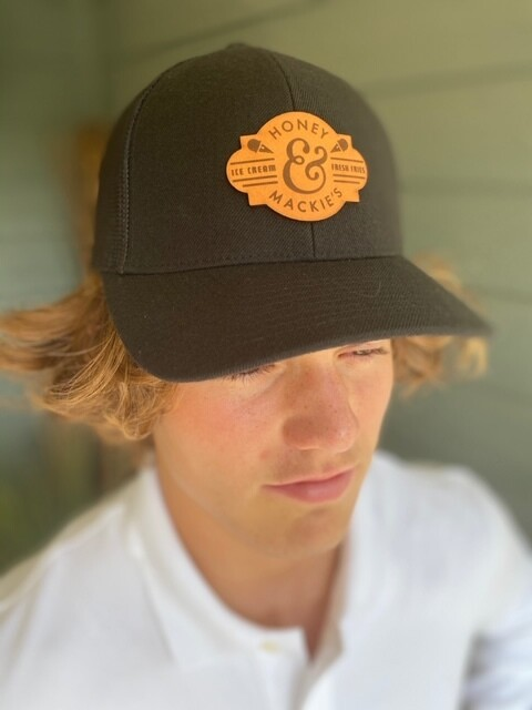 Solid black mesh back hat with leather MN patch