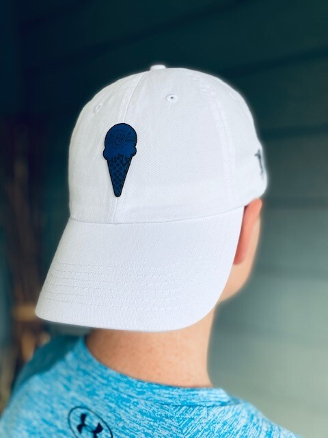 White fabric hat with blue leather cone patch
