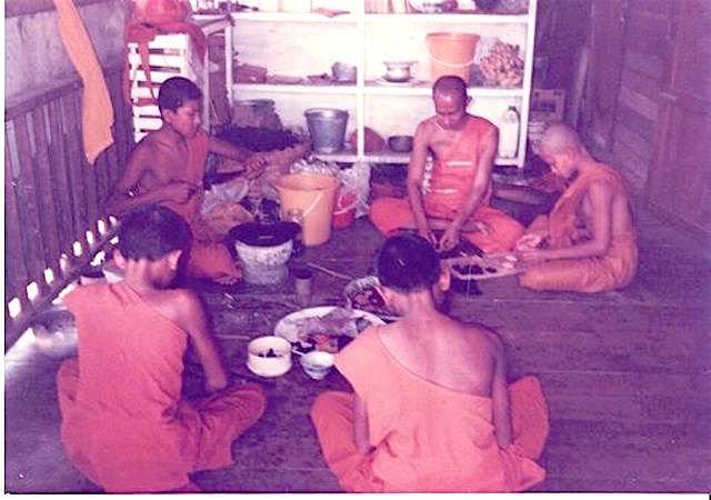 Luang Por Phaew making the Pra Roop Muean Nuea Krang amulets