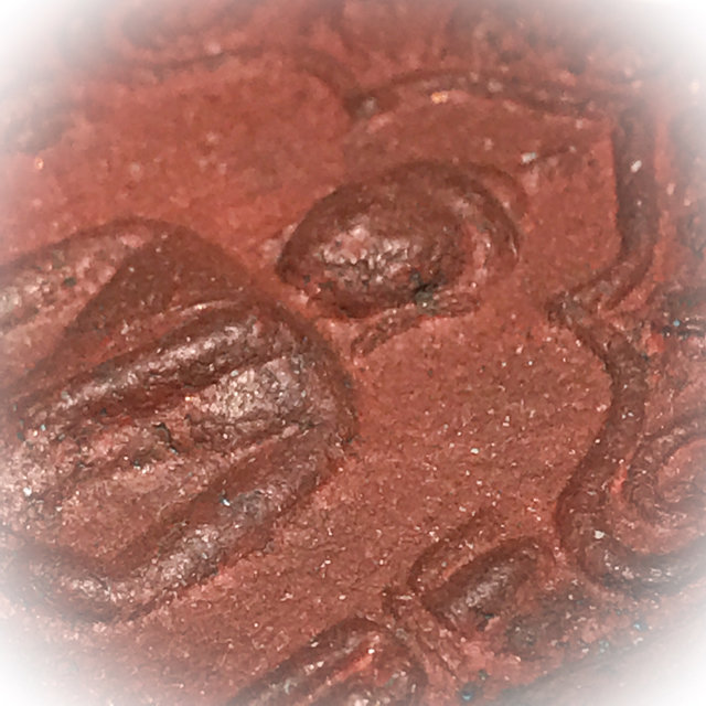 Macro close up of the Red Muan Sarn Sacred Powders of front face upper section