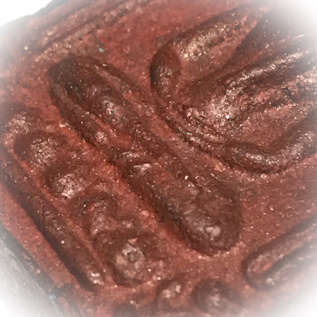 Macro close up of the Red Muan Sarn Sacred Powders of front face mid section