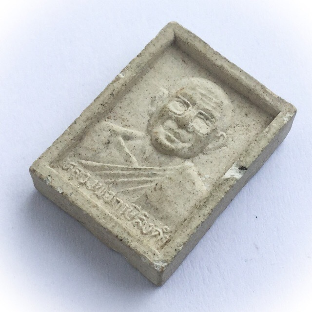 Luang Por Ruesi Ling Dam on rear face of amulet