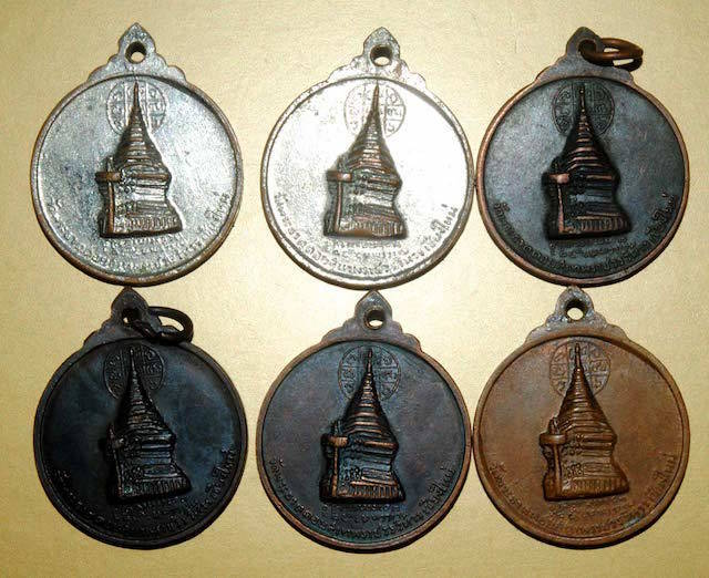 Rear faces of the 6 different models in different sacred metals of the Rian Kroo Ba Srivichai Amulet