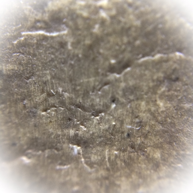Close-Up Macro Image of the Muan Sarn Sacred Powders of rear face of amulet