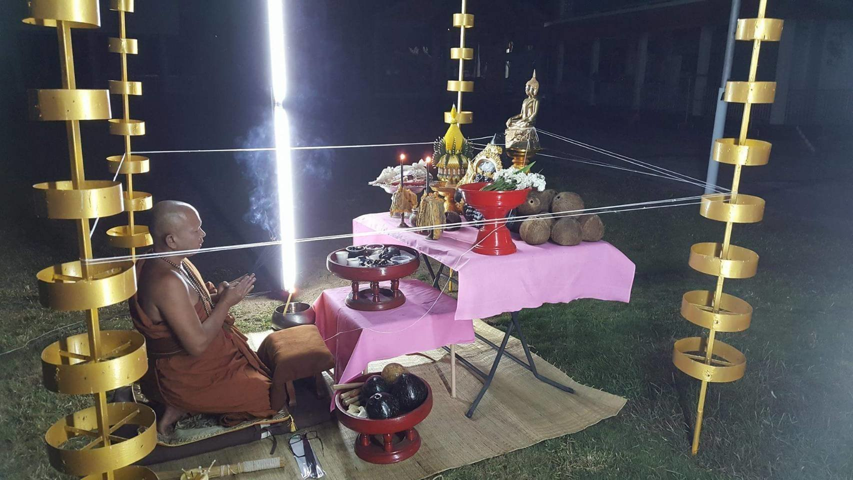 Pra Ajarn Gorp Chai Blessing Rahu Amulets and Meed Haek during a Lunar Eclipse on the 150th anniversary of Wat Mae Ya