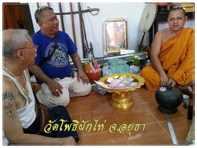 Ajarn Meng donates money to the temple of Wat Po Pak Hai in Ayuttaya