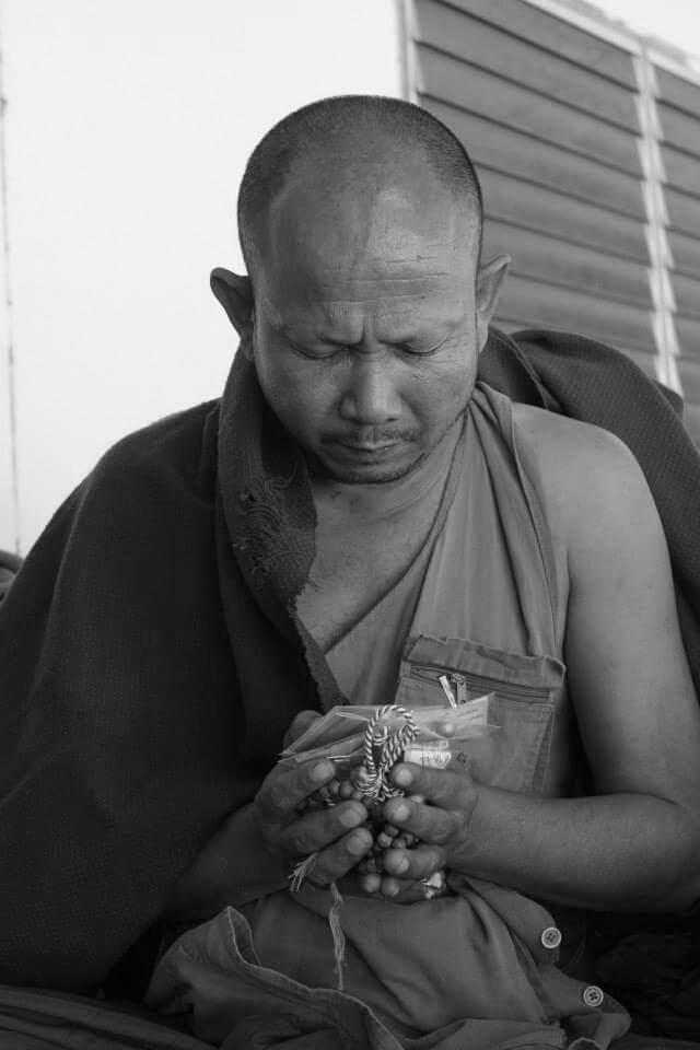 Pra Ajarn Gorp Chai Blessing the Takrut Nak Kor Kam Amulets