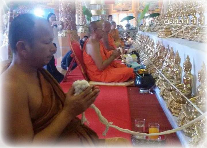 Pra Ajarn Gorp Chai performing Buddha Abhiseka Ceremonial Blessings