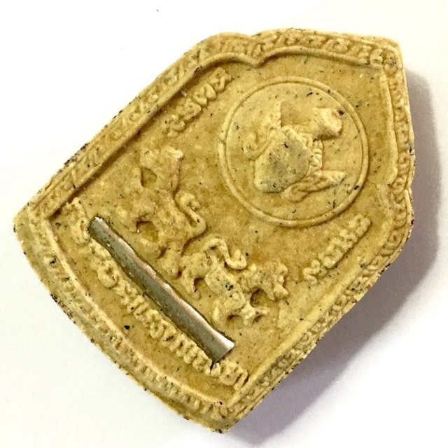 Rear face of amulet shows Por Gae Lersi Dta Fai, Takrut, and Rachasri Lions
