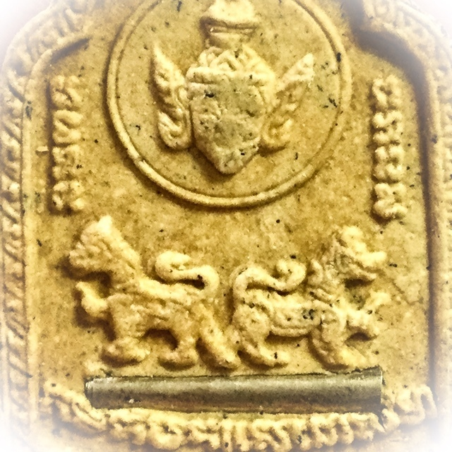 Lersi Hermit God and Rachasri Lions with Takrut in rear face of amulet