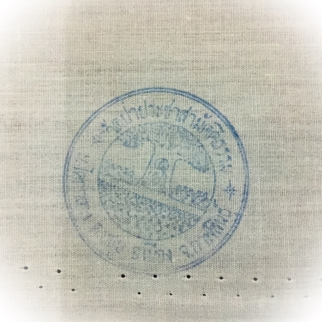 The rubber inkstamp of the temple is stamped onto the cloth