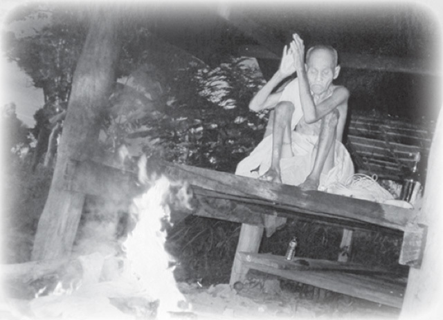 Luang Por Suang Burning things in the Fire