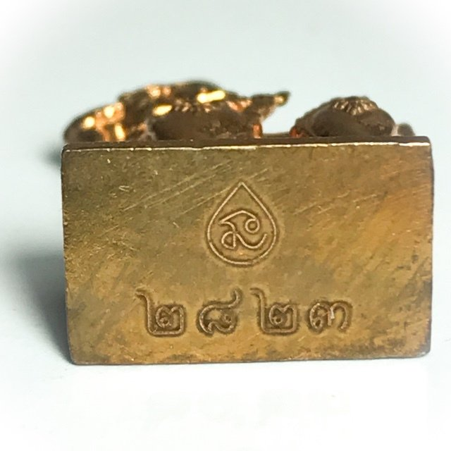 Code stamp on base of amulet