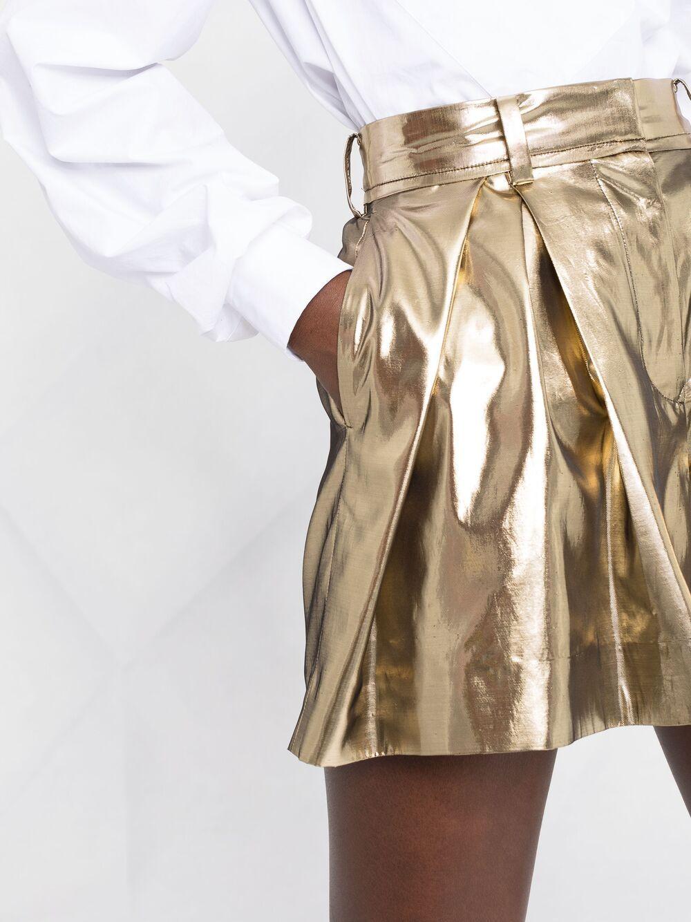 shorts in tessuto laminato oro SACAI | Shorts | 21-05565951
