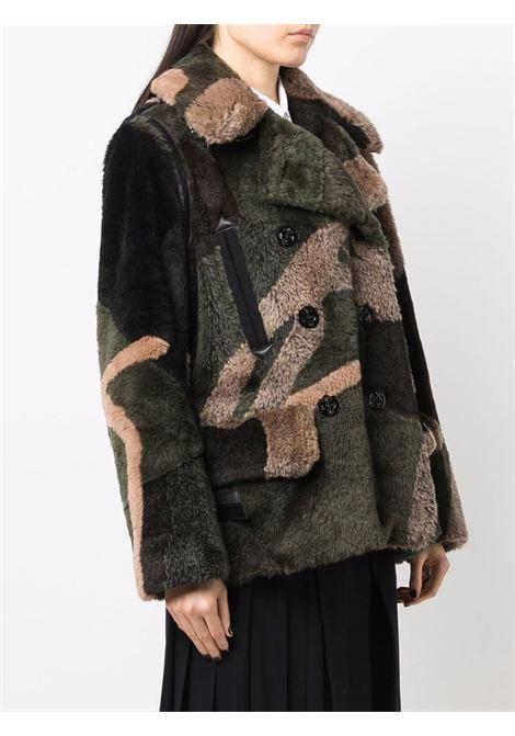 giaccone doppiopetto in eco-pelliccia stampa KAWS SACAI | Giaccone | 21-05677936