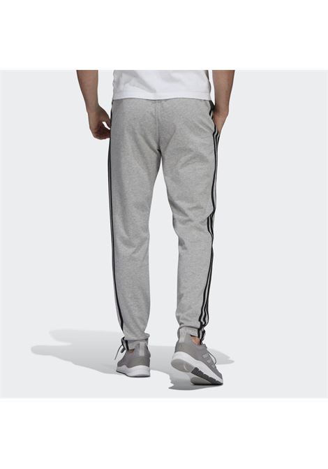 ADIDAS PANTALONI ESSENTIAL SINGLE JERSEY TAPERED  stripe essential single jersey tapered open pants ADIDAS | PANTALONE | GK8998-