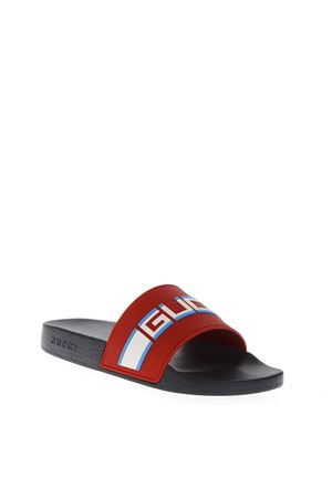 RED RUBBER SLIDE SANDALS WITH EMBOSSED GUCCI LOGO FW 2018 GUCCI | 87 | 522884JC2006562
