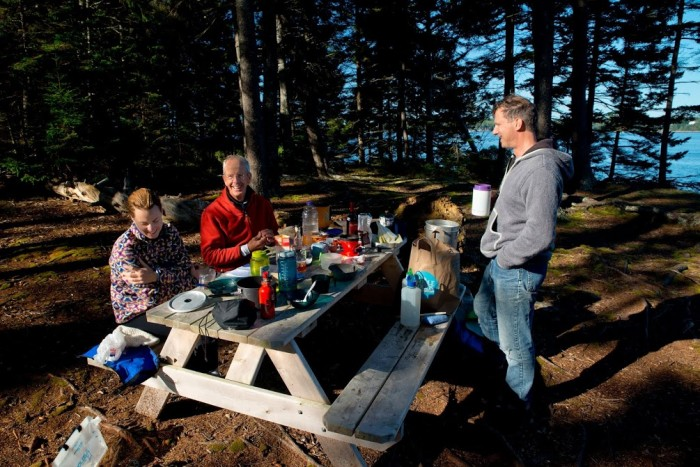 Kristen Roos, Dick Gilbane, and Doug Welch enjoying breakfast on Ram Island in the Sheepscot River.