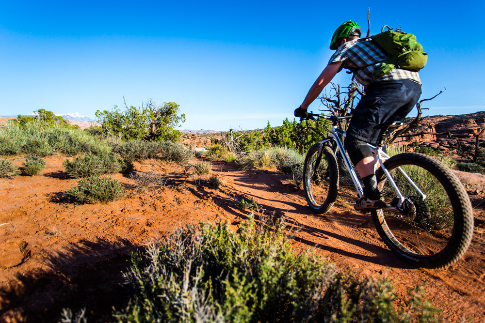 Casey Krueger riding the Advocate Cycles Hayduke on the Captain Ahab Trail near Moab, Utah