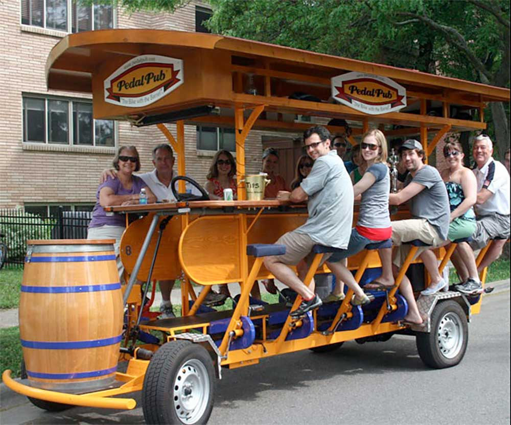 Revelers enjoying libations on a Pedal Pub