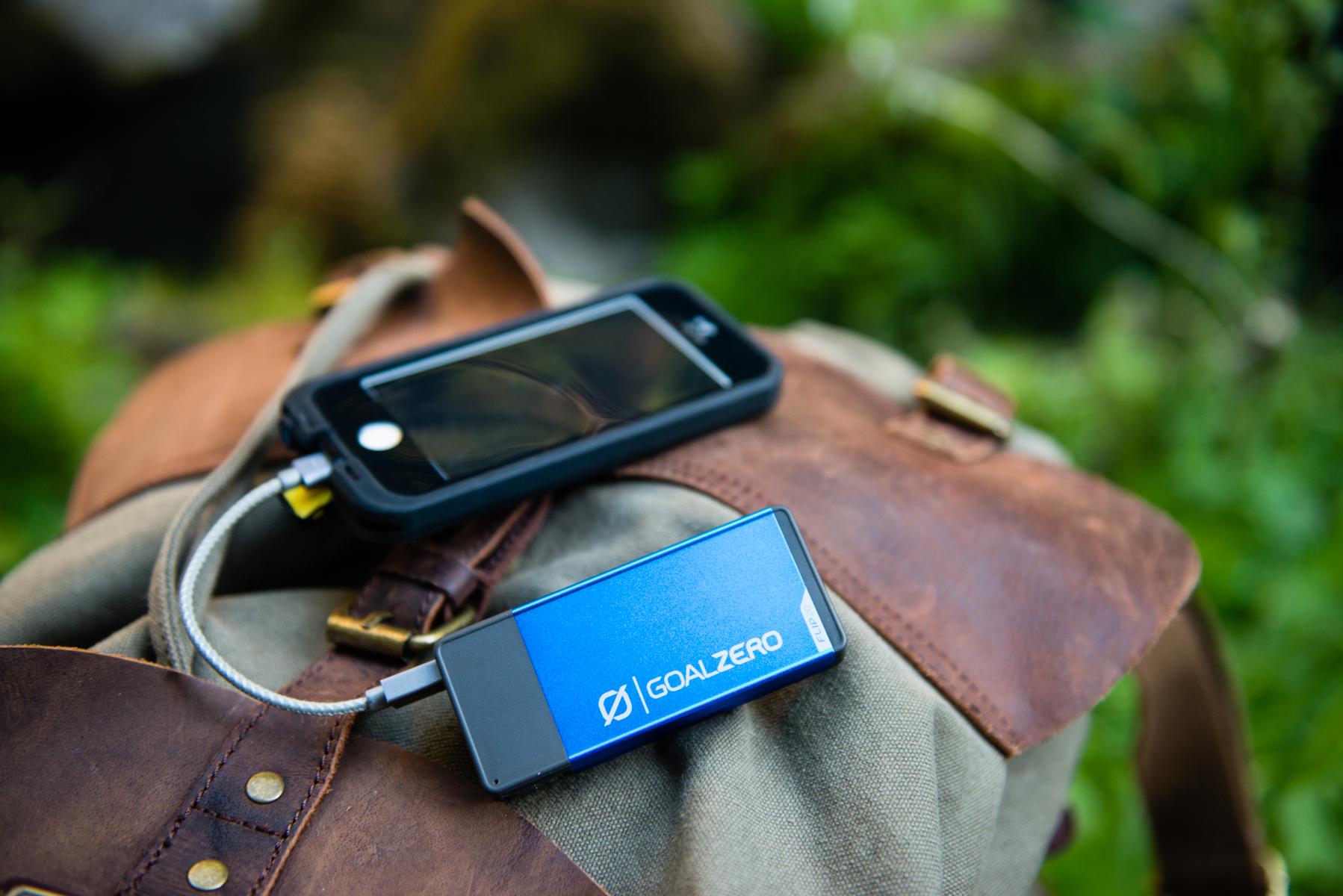 Goal Zero Flip 20 Recharger charging phone in the woods Photo: Travis Burke.