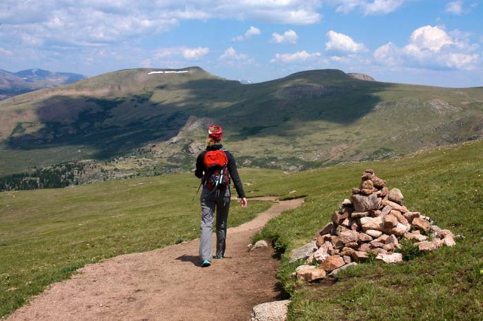 A hiker high on Mount Bierstadt on a clear day; photo by Sean McCoy