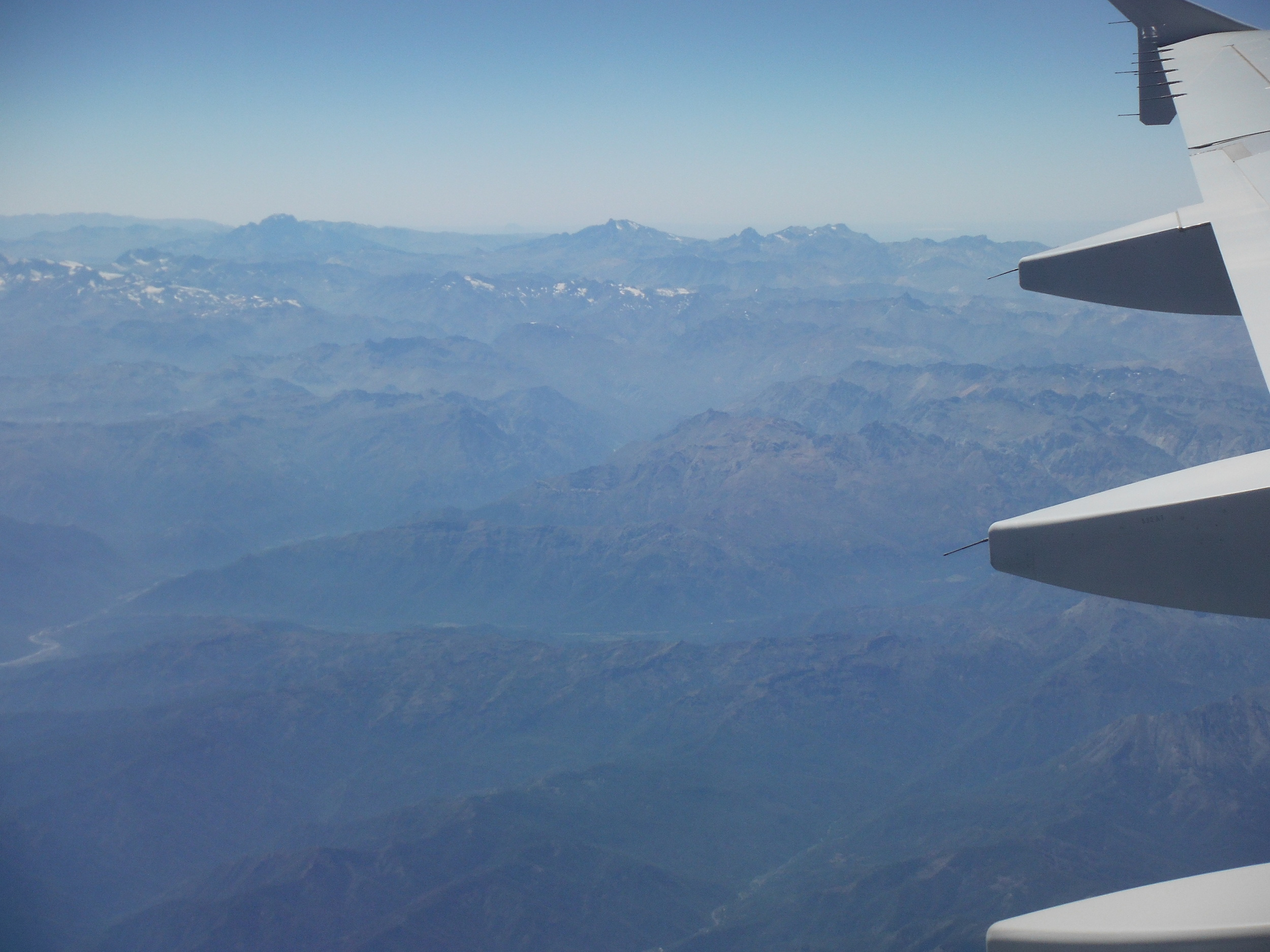 Airplane over mountains