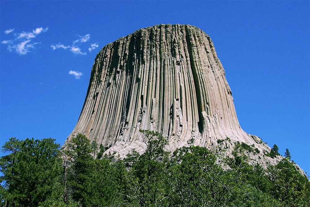 Wyoming's Devils Tower was the first declared United States National Monument, established in 1906; photo via Wikipedia