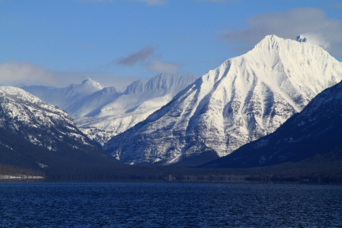 The Continental Divide seen in the background from the shore of Lake McDonald; photo by David Restivo, NPS
