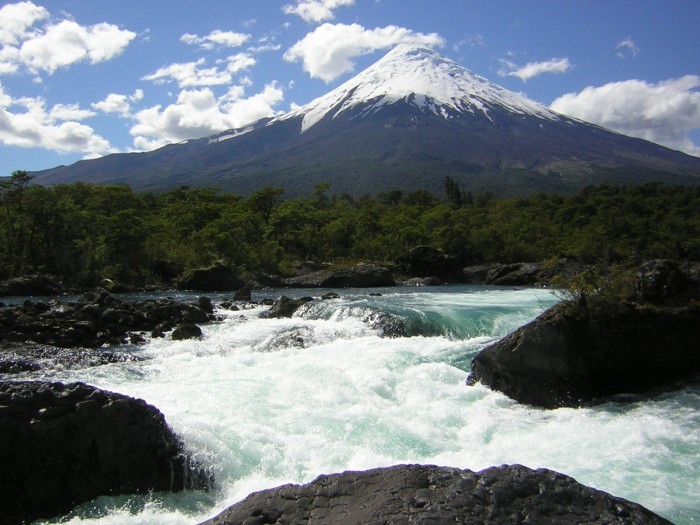 """""""Volcano Osorno and Petrohué waterfalls"""" by I, Rlohaus. Licensed under CC BY-SA 2.5 via Commons - https://commons.wikimedia.org/wiki/File:Volcano_Osorno_and_Petrohu%C3%A9_waterfalls.JPG#/media/File:Volcano_Osorno_and_Petrohu%C3%A9_waterfalls.JPG"""