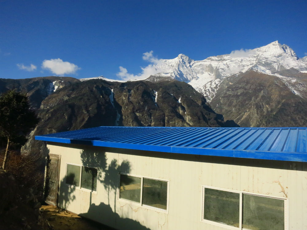 The nearly completed relief center sits at the base of Mt. Everest