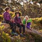 Three-Women-Hiking-in-KEEN-Versatrail-sitting-on-log