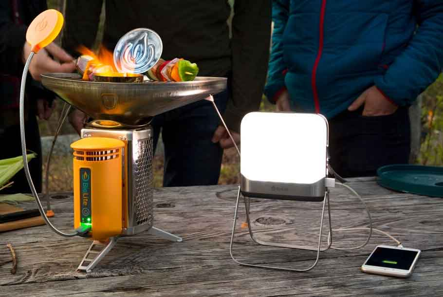 camp stove next to lantern