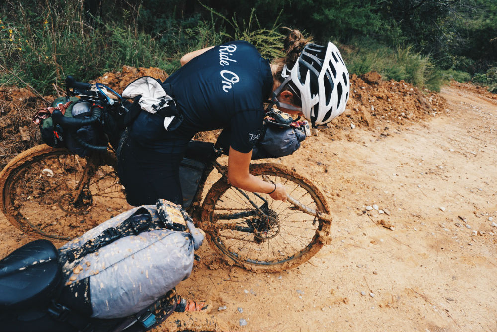 sarah swallow cleaning mud off bike tires