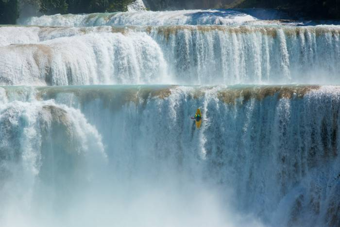 kayaker dropping waterfall
