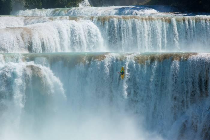 kayaker dropping waterfall