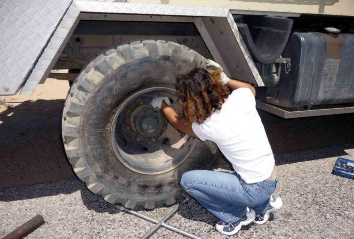 changing tire off road motorhome