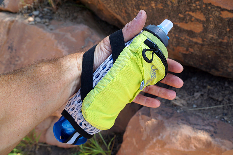 running water bottle on hand