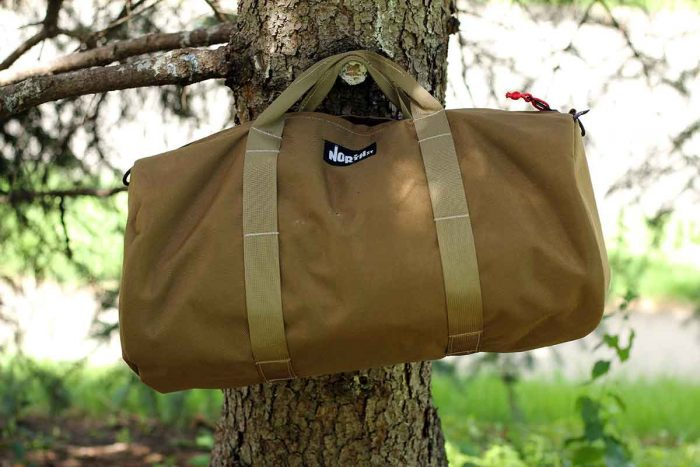duffel bag in a tree