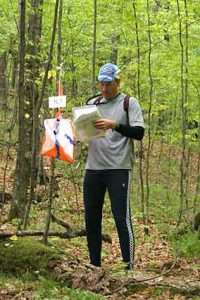orienteer in woods