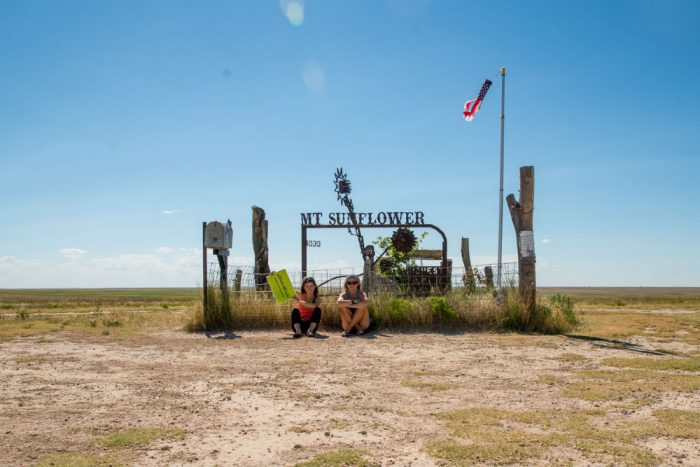 Miller and Arnot at the topographical 'peak' of Kansas, Mt. Sunflower