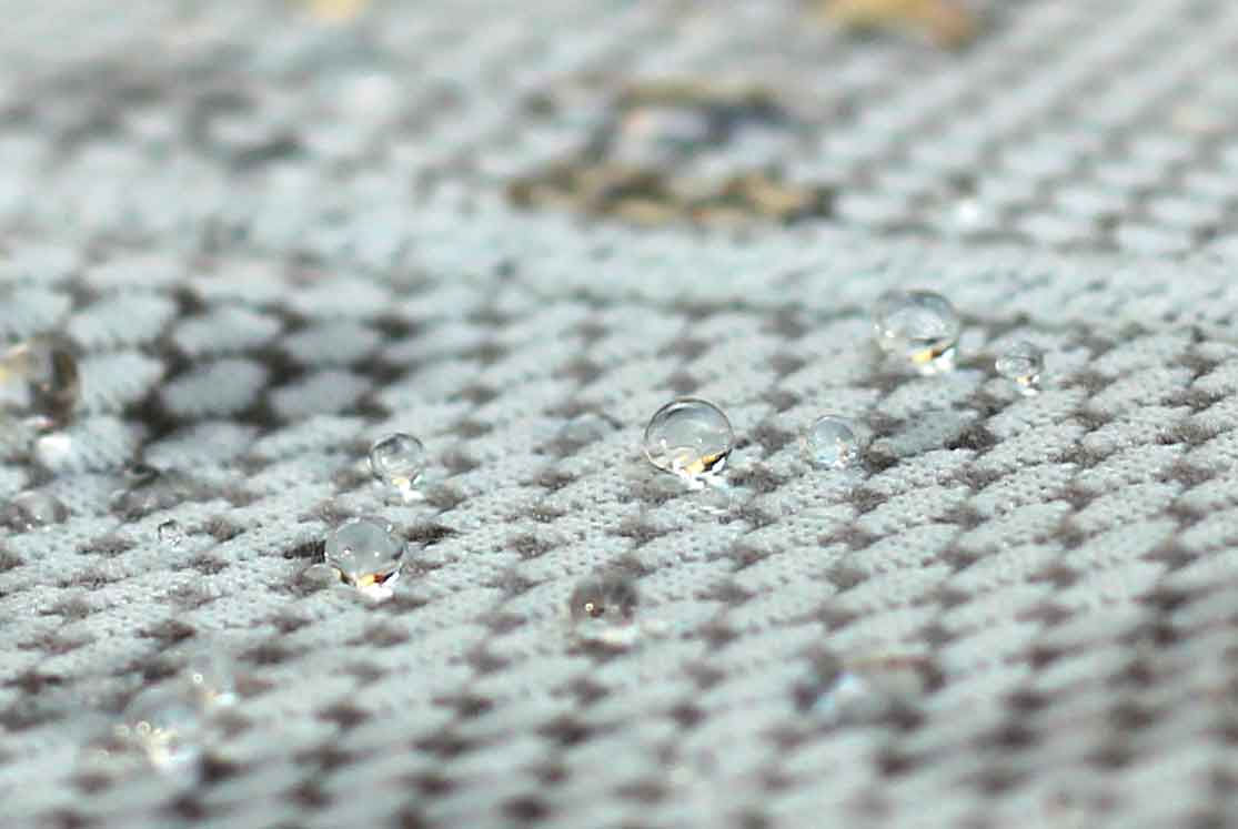 Close-up: A complex knit, water beads on some Delta fibers and absorbs into others