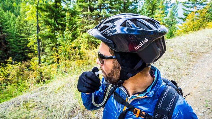 Hydrating on singletrack wearing Bolle The One Road helmet