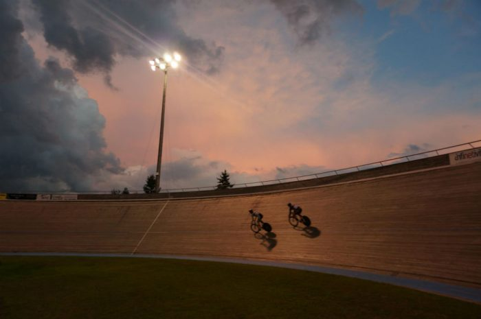 Two riders turn laps as dusk settles on the state's current velodrome, slated to close in 2019