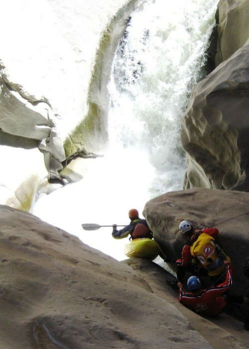 eugene buchanan sliding kayak down a boulder in cruz del condor