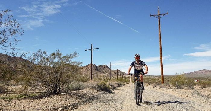 adam-riding-gravel-bike