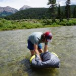 Dunking Backcountry Bed Elite Sleeping Bag In River