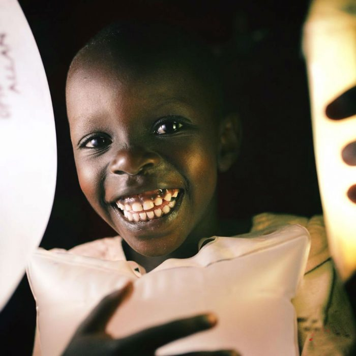 luminaid-child-in-africa-give-light